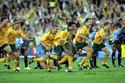 Australia qualifies for the 2006 World Cup after defeating Uruguay   y
